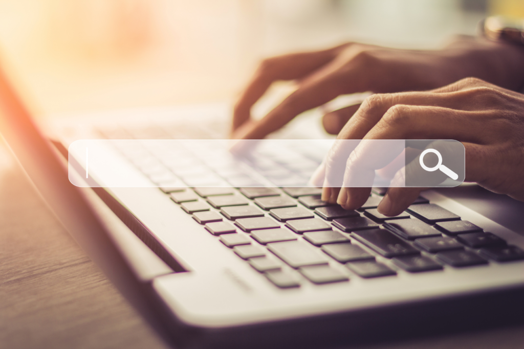 SEO is critical to your business - example of a person typing into Google on laptop