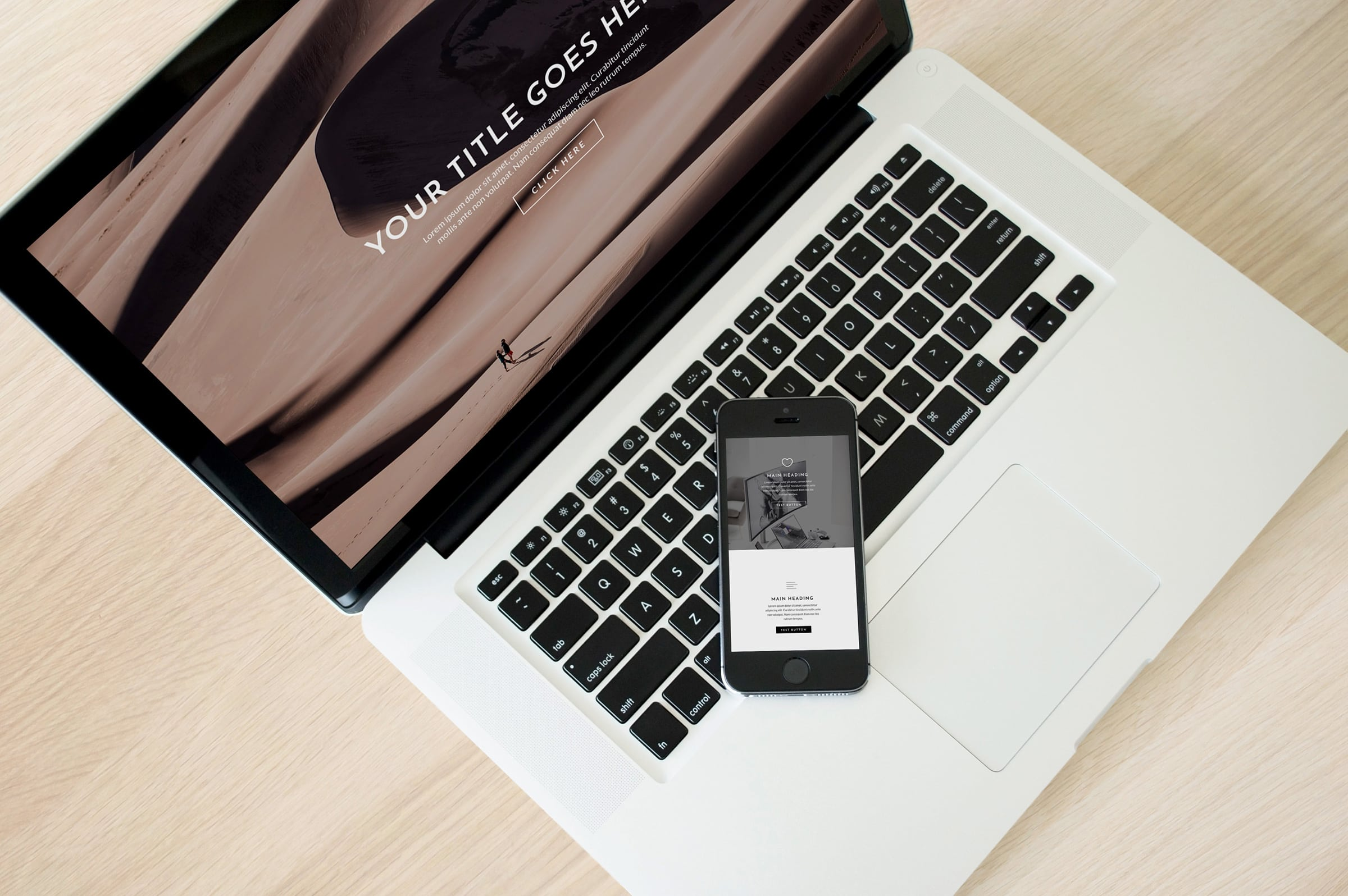 Laptop and cell phone showcasing responsive website design